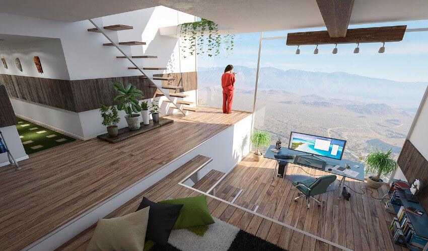 Ein Arbeitszimmer einer Villa mit einer Glasfassade und Blick Richtung unbebauter Natur und Berge.